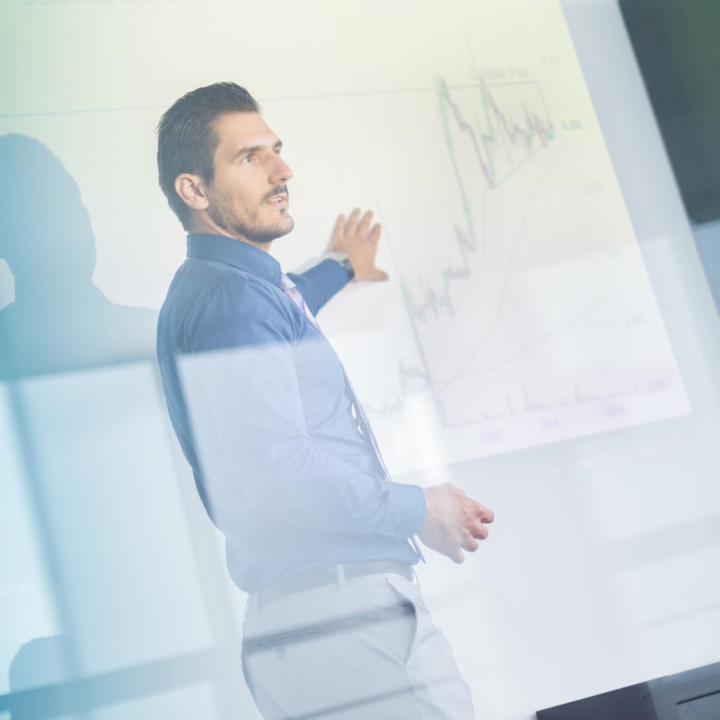 man analyzing a chart